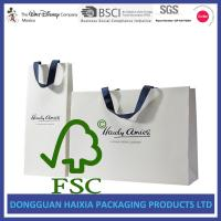 China Ribbon Handle Kraft Paper Gift Bags OEM Logo Printed White Gift Carrier on sale