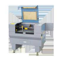 China CO2 Laser Wood Engraving Cutting Machine With Motorized Up And Down Table on sale