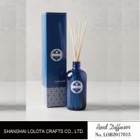 Quality transparent blue color reed diffuser with natural stick and pattern folding box for sale