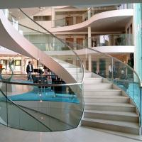 Quality Wood Step Glass Rails Curved Staircase with Stainless Steel Stringer and Glass Railing for sale