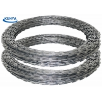 China Hot Dipped 7KG Concertina Barbed Wire 12 Inch Razor Galvanized BTO CBT on sale
