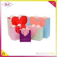 China Heart-Shaped hand length handle paperboard wedding gift bag on sale
