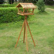 China Wooden Bird House with Stable Four Legs and Straw Roof on sale