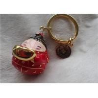 Quality Chinese Style Ceramic Fat Baby Gold Ingot Key Chain In Red Coat for sale