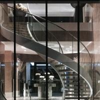 Quality Indoor / Outdoor Stainless Steel Double Beam Curved Wood Stairs with Glass Railing for sale