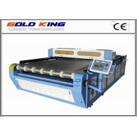 China Auto-feeding fabric laser cutting machine for wood, fabric, acrylic with best laser cnc router price on sale