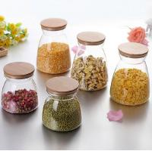 China Glassware Jar Glass Coffee Tea Jar Kitchenware Storage Jar Wooden Lid Glass Cookie Jar on sale