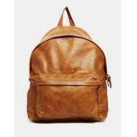 Tan color cross body leather bag